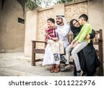 arabic family playing with child | Shutterstock . vector #1011222976