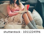 coziness at home  girl hygge... | Shutterstock . vector #1011224596