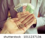 euros in hand. the concept of... | Shutterstock . vector #1011237136