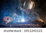 welder working at the factory... | Shutterstock . vector #1011242122