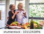 senior couple cooking healthy...   Shutterstock . vector #1011242896