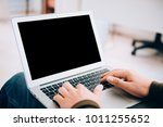 man working with laptop in... | Shutterstock . vector #1011255652