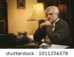 pensive retro senior man writer ... | Shutterstock . vector #1011256378
