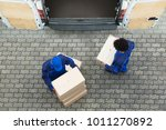 high angle view of delivery men ... | Shutterstock . vector #1011270892