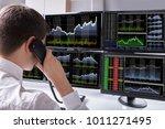 stock broker talking on... | Shutterstock . vector #1011271495