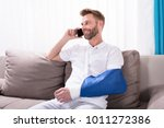 young man with fractured hand... | Shutterstock . vector #1011272386