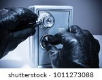 close up of a thief's hand... | Shutterstock . vector #1011273088