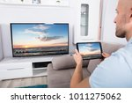 man connecting television... | Shutterstock . vector #1011275062