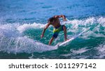 riding the waves. costa rica ... | Shutterstock . vector #1011297142