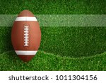 american football ball on green ... | Shutterstock . vector #1011304156