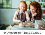 redhead mother and daughter... | Shutterstock . vector #1011362032
