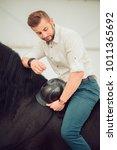 handsome man in a shirt riding... | Shutterstock . vector #1011365692