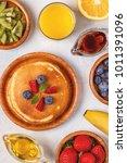 pancakes with fruit  honey ...   Shutterstock . vector #1011391096
