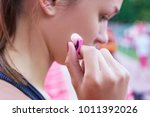 woman putting earphones before... | Shutterstock . vector #1011392026