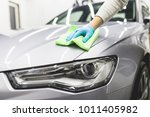 a man cleaning car with... | Shutterstock . vector #1011405982