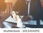 business partners handshaking... | Shutterstock . vector #1011414292