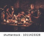 medieval people eat and drink... | Shutterstock . vector #1011423328