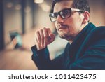 young specialist in coworking... | Shutterstock . vector #1011423475