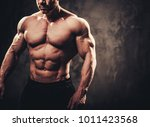man showing his muscular body. | Shutterstock . vector #1011423568