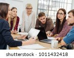 group of diverse young adults... | Shutterstock . vector #1011432418
