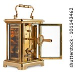 Antique Carriage Clock with rear door open showing key - stock photo