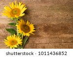 Sunflowers On The Old Wooden...