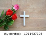 Roses and crosses on wooden...