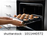 Woman Taking Baking Tray With...