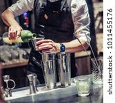professional bartender making...   Shutterstock . vector #1011455176