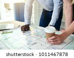 two architects leaning on a... | Shutterstock . vector #1011467878