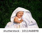 child sunbathing on green grass   Shutterstock . vector #1011468898