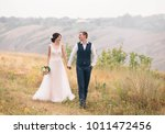 wedding day. stylish young... | Shutterstock . vector #1011472456