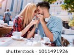 flirting in a cafe. beautiful... | Shutterstock . vector #1011491926