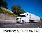 white modern big rig semi truck ... | Shutterstock . vector #1011507352
