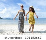 woman hang out  together on sand beach with blue sky background - stock photo