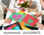 young couple making origami... | Shutterstock . vector #1011550072