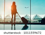 silhouette woman travel with... | Shutterstock . vector #1011559672