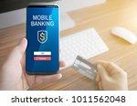 a man holding mobile smart...   Shutterstock . vector #1011562048