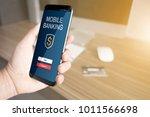 a man holding mobile smart... | Shutterstock . vector #1011566698