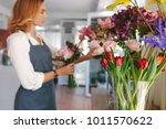 small business. female florist... | Shutterstock . vector #1011570622