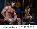 sexy strong bodybuilder... | Shutterstock . vector #1011583012