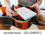 learning to play the guitar.... | Shutterstock . vector #1011588922
