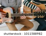 learning to play the guitar.... | Shutterstock . vector #1011588982