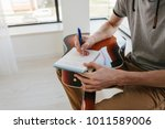 learning to play the guitar.... | Shutterstock . vector #1011589006