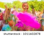 girl celebrate holi festival | Shutterstock . vector #1011602878