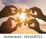 silhouette four hands trying to ... | Shutterstock . vector #1011630712