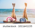 two woman in bikini lie on the... | Shutterstock . vector #1011641155
