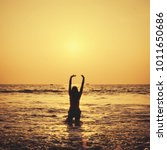 Small photo of Happy Carefree Woman Enjoying Beautiful Sunset on the Beach. Old lens style