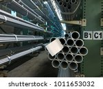 stainless steel tube with label | Shutterstock . vector #1011653032