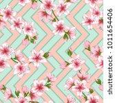 floral cherry blossom patter... | Shutterstock .eps vector #1011654406